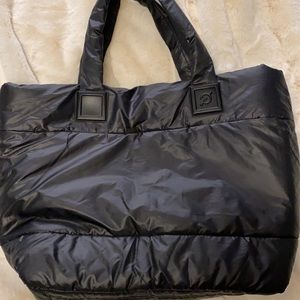 Peloton black quilted tote bag